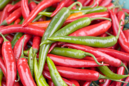 A bowl of red and green chillies photo