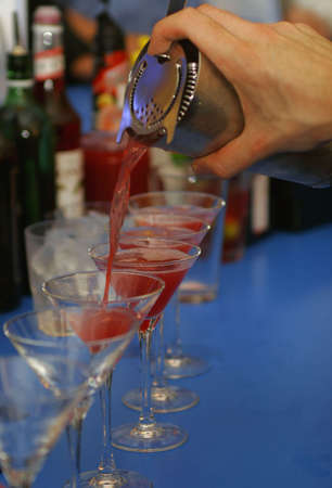 invited: Pouring a line of cocktails