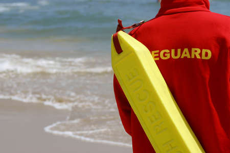 diving save: A lifeguard watching a sandy shoreline Stock Photo