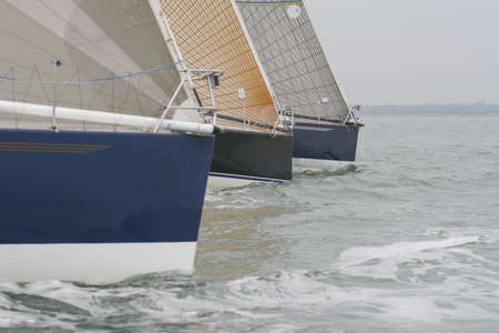 symetry: Three yachts racing to a close finish Stock Photo