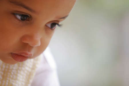 A beautiful mixed race girl in deep thought Stock Photo - 275884