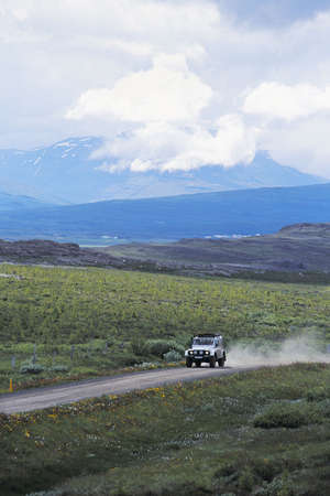 four wheel: A four wheel drive vehicle driving through the Icelandic wilderness