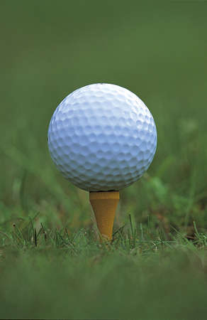 Close up of a golf ball on a tee Stock Photo