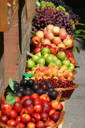 priced: Fruit for sale at a market on the streets of Siena, Tuscany, Italy