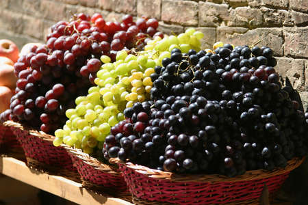 Grapes for sale at a market on the streets of Siena, Tuscany, Italy Stock Photo