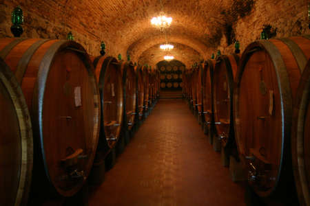 An Italian wine cellar full of barrels of Chianti Stock Photo