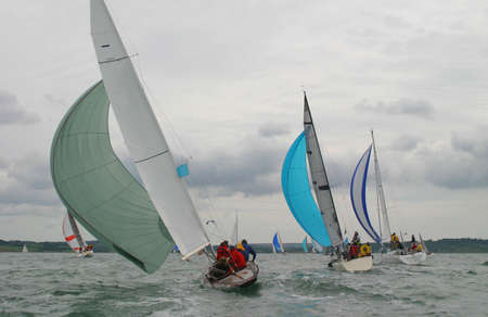 Yachts racing in a stormy sea.