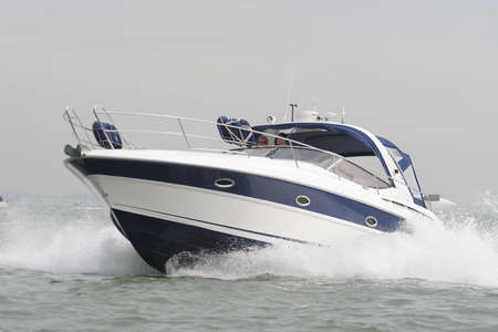 speedboat: A speedboat powers through the sea off the English coast