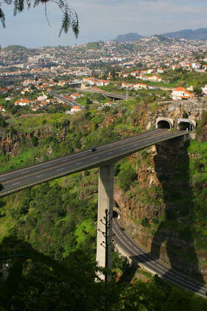 cut through:  Elevated roadway cut through the mountain side in Funchal, Madeira.