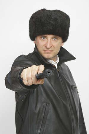 A gun toting, scarred Eastern european gangster photo