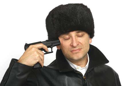 sufferer: A Russian man Holds a gun to his head