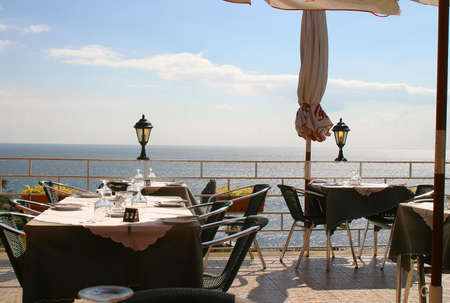 A restaurant looks out across the sea in Funchal on the coast of Madeira Stock Photo