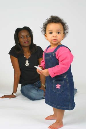 A beautiful mixed race little girl and her mother