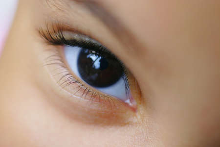 A close up of a childs brown eye shot with  a very shallow depth of field