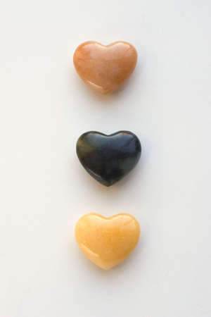 Three agate hearts shot on a white background Stock Photo