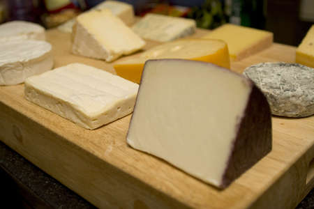 cheeses: A cheese board with a selection of world cheeses Stock Photo