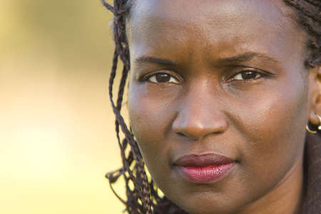 Close up of a beautiful black woman with a thoughtful look on her face Stock Photo
