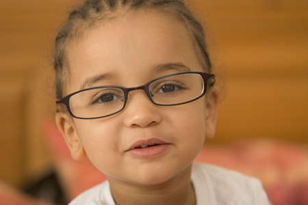 studious: A beautiful young mixed race girl wearing slightly oversized glasses