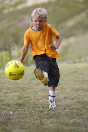 scores: A young boy shoots and scores