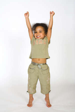 on tiptoes: A beautiful mixed race girl having a big stretch Stock Photo