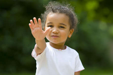 coy: A beautiful mixed race girl holds up her hand and gives the order to stop.
