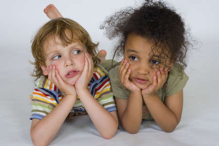 blonde boy: A beautiful mixed race girl and a blonde boy playing together