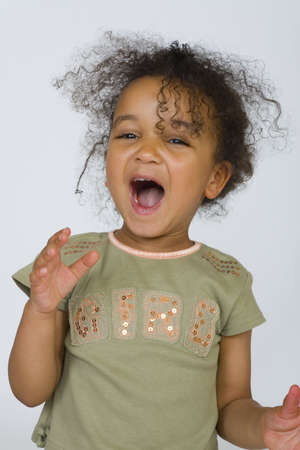 A beautiful mixed race girl singing out with joy.