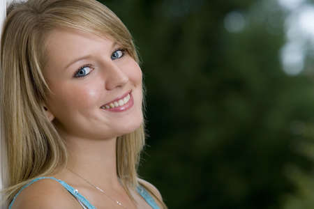 A beautiful young woman with bright blue eyes and blonde hair. Stock Photo