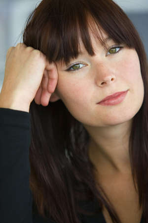 introspective: A beautiful young woman with green eyes stares wistfully into the camera