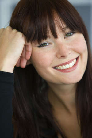 appealing attractive: A beautiful young woman with green eyes laughing and happy