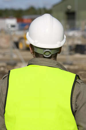 overseer: A construction worker on site and dressed in safety clothing