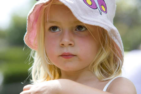 A cute little blonde girl with an innocent look on her face. Stock Photo - 628894