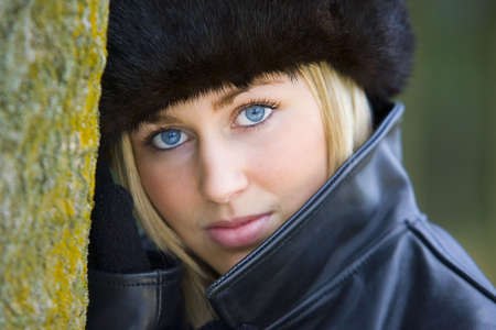 blonde blue eyes: A beautiful blue eyed young woman wearing a Russian fur hat.