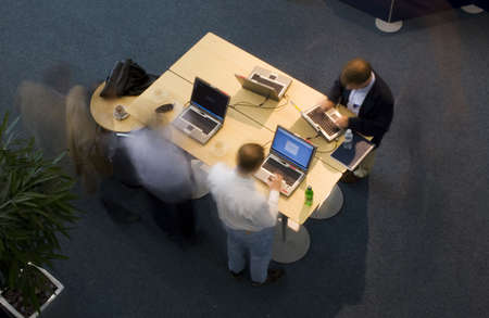 tradeshow: Overhead long exposure shot of executives at a conference working on laptops Stock Photo