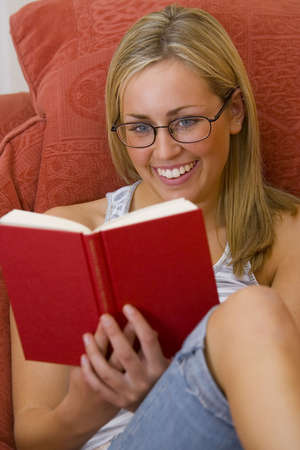 hardback: A beautiful blue eyed, blond haired, woman relaxing and reading a hardback book