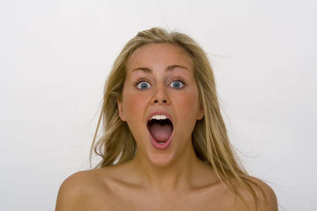 eyes wide: A beautiful blond haired blue eyed woman in open mouth shock!
