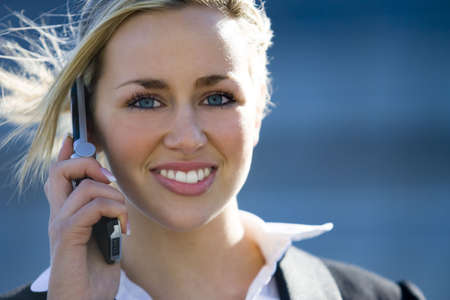 A beautiful young blond female executive on her mobile phone Stock Photo - 815873
