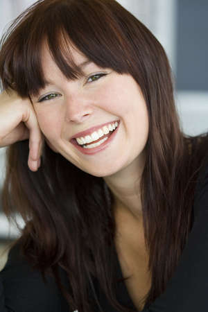 A beautiful green eyed young woman relaxed and laughing photo