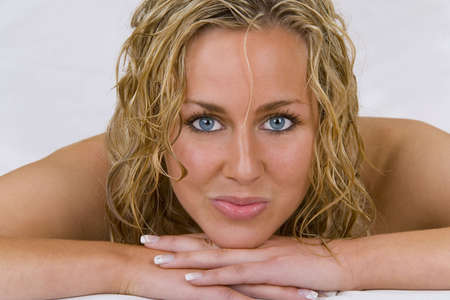 Studio shot of a beautiful young blond model looking refreshingly beautiful with wet hair. photo