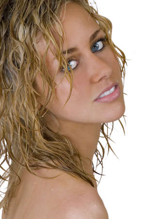 Isolated studio shot of a stunningly beautiful young blonde woman with wet hair and blue eyes. photo