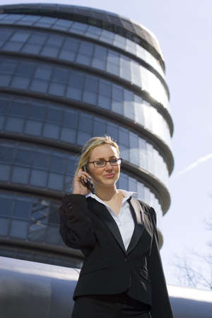 A beautiful young female executive on the phone in a hi-tech urban surrounding Stock Photo - 945217