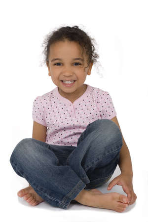 legged: Isolated studio shot of a beautiful mixed race little girl sitting cross legged and laughing, created with a drop shadow. Stock Photo