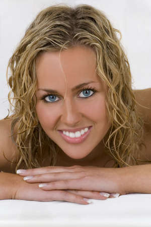 Studio shot of a stunningly beautiful young blond woman relaxed and smiling Stock Photo - 989545