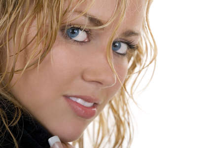 Isolated close up studio portrait of a gorgeous young blond woman with striking blue eyes and wet hair  photo