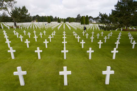 normandy: The graves of World War 2 US soldiers who paid the ultimate price amongst many in the cemetery at Omaha Beach in Normandy Northern France Stock Photo