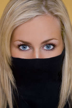 Close up studio portrait of a classically beautiful young woman's stunning blue eyes