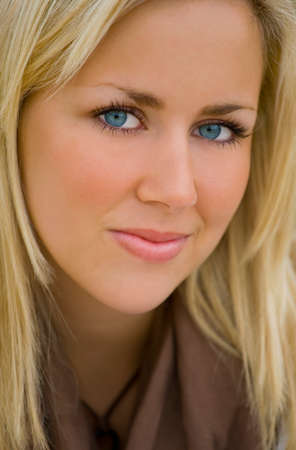 blond brown: Close up portrait of a beautiful young blond woman with stunning blue eyes
