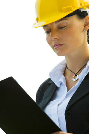 overseer: Isolated photo of a female construction worker with a clipboard and hard hat