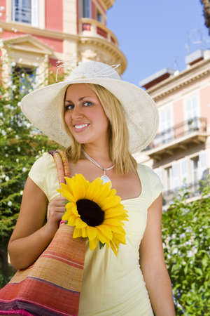 absolutely: An absolutely gorgeous blond haired blue eyed woman walking through a Mediterranean city Stock Photo
