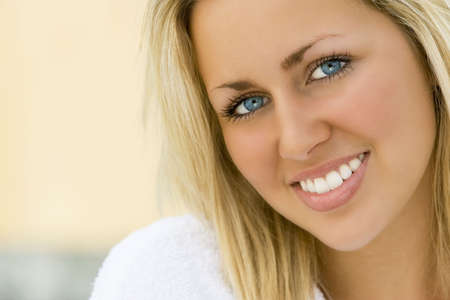 An absolutely gorgeous blond haired blue eyed woman with a gorgeous toothy smile Stock Photo